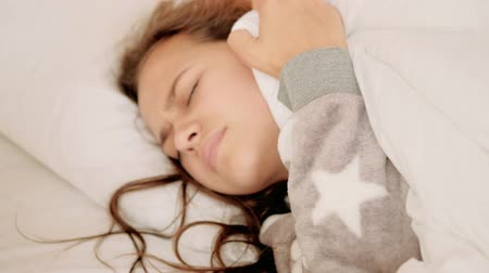 displeasure : Troubled sleep. Anxiety disturbance discomfort. Annoyed girl suffering from nightmares. Stock Footage