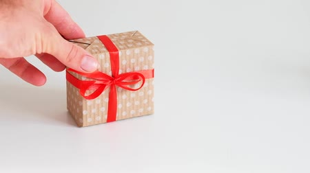 polca : Birthday present. Greeting congratulation surprise. Man hand putting gift box on white surface. Stock Footage