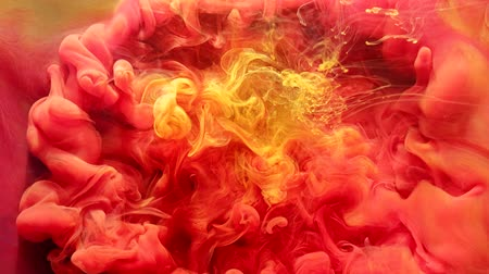 vertical : Ink water explosion. Sorcery chemistry. Pink yellow smog effect.