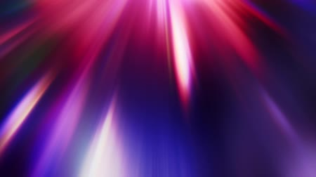 title : Glowing rays. Gemstones radiance. Blur multicolor beams motion on black background for overlay.
