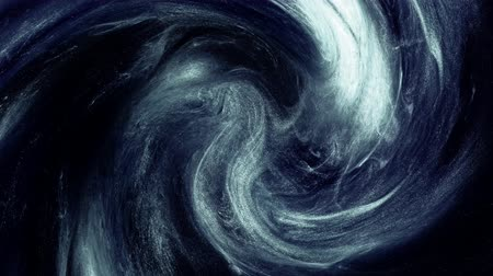 kreativitás : Steam swirl intro. Mysterious vortex. White glitter smoke motion on navy blue background. Stock mozgókép
