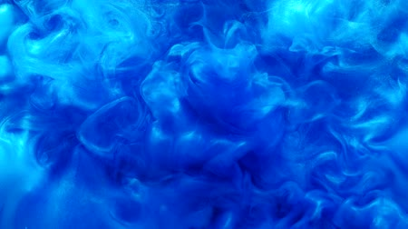 roztavený : Abstract fume background. Fabulous waves. Blue glowing glitter fluid splash motion.
