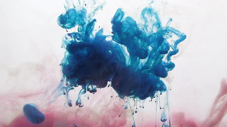 bluestone : Paint drops overlay. Underwater burst. Blue smoke cloud motion on white background for transition.