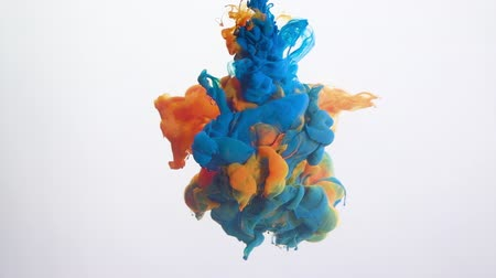 donanma : Paint shot in water. Mysterious alchemy. Navy blue orange ink blend motion on white background.
