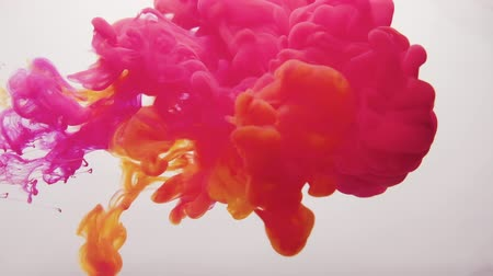 yellow ink : Paint cloud motion. Juicy splash. Magenta pink orange smoke puff on white background for intro.