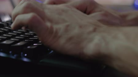 escritor : Software engineering. Cyber security. Male hands typing programming code on black keyboard. Stock Footage