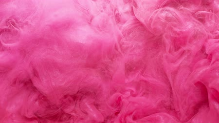 pink : Flowing vapor layer. Glam explosion. Glitter magenta pink smoke cloud motion effect for transition. Stock Footage