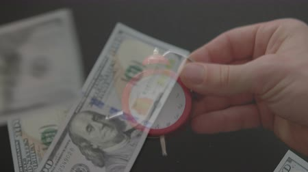 hurry up : Fast money. Effective time management. Male hand showing alarm clock over dollars rain. Stock Footage