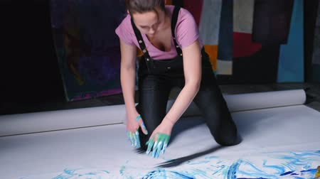 bluestone : Art therapy. Healing power of craft. Woman releasing stress with finger painting. Stock Footage