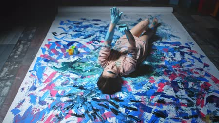 obsession : Creative leisure. Positive power of art. Happy woman dirty with paint enjoying hand dance on floor.
