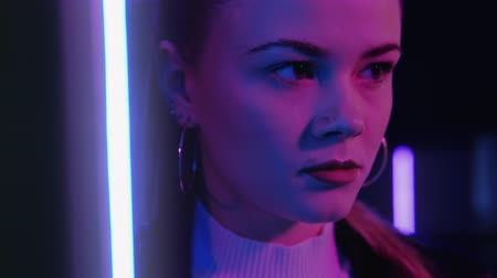 ошибки : Neon girl portrait. Disappointment regret. Thoughtful young woman daydreaming in purple glow.