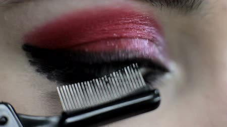 Eye makeup. Professional artist tools. Eyelash comb removing clumps. Stock Footage