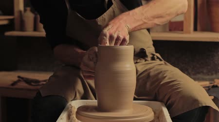 Clay pottery. Handmade manufacturing. Man hands creating vase on wheel at workshop. Stock Footage