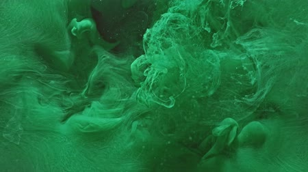 damp : Colored vapor overlay. Toxic waste. Green liquid splash effect for video editing.