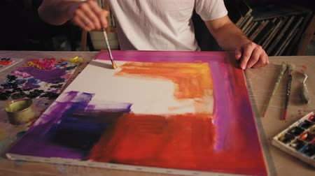 Art therapy. Soul healing. Inspired man creating colorful abstract work with acrylic paint. Stock Footage