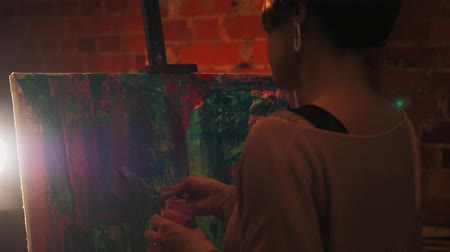 Passion for painting. Hobby leisure. Talented woman creating abstract artwork in loft studio. Stock Footage