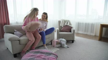 friendship bff. fun leisure pastime. girlfriends at home chatting, writing in the diary. young teenage mates Stock Footage