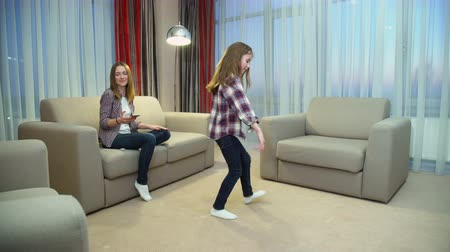 fun family leisure. music hobby. childhood joyful moments. little girl dancing for her mom Dostupné videozáznamy