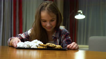 child nutrition problems. unhealthy habits. sweets temptation. little girl with a sweet tooth. Dostupné videozáznamy