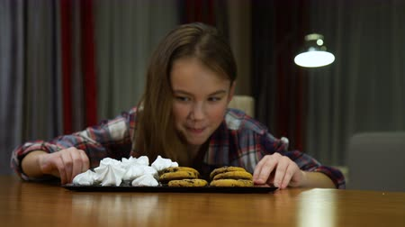 child sugar addiction. unhealthy eating habits. sweets overeating. little girl is a sweet tooth. Dostupné videozáznamy