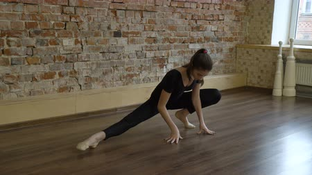 sport fitness. yoga gymnastics. healthy lifestyle. young fit teenage girl warming up in a studio
