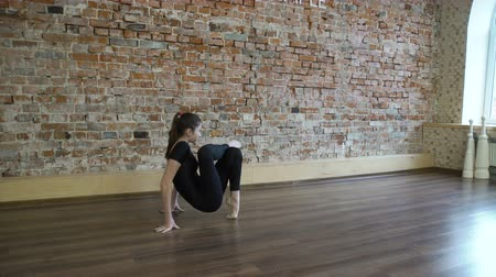 sport fitness. yoga gymnastics workout. healthy lifestyle. young fit teenage girl stretching in a gym