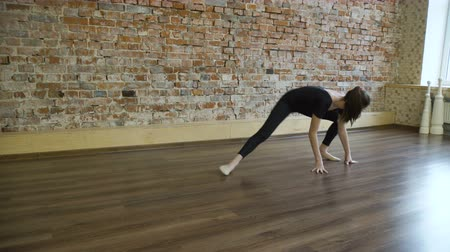 sport fitness. yoga gymnastics. flexibility exercise training. young fit teenage girl warming up stretching in a gym