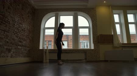 sport fitness. gymnastics. healthy lifestyle. flexibility workout. young fit teenage girl warming up in a studio