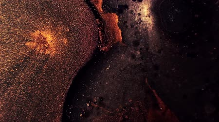 waste water : Liquid paint motion. Toxic waste leak. Brown glitter fluid mix. Stock Footage