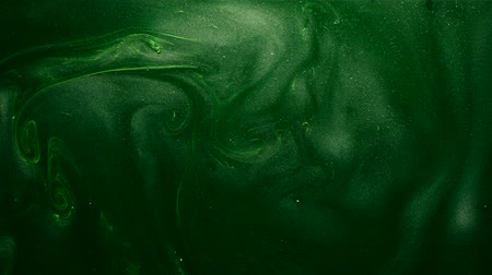 shimmer : Paint swirl. Mysterious fume. Glitter liquid ink motion. Eden green pantone color.