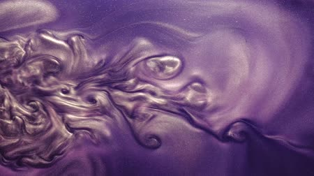 shimmer : Paint flow. Glitter cloud. Vertical purple liquid ink motion.