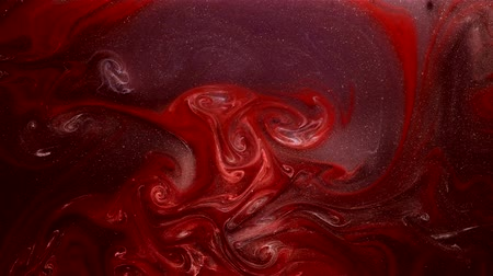 spilled : Paint mix motion. Mysterious shimmer. Red purple ink flow.