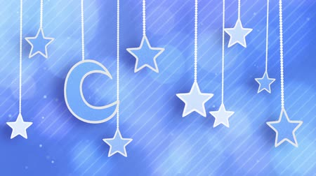 star shape : night time decoration moon and stars dangling on strings loop Stock Footage