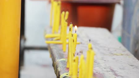 buddhista : row of candles in buddhistic temple outdoor Stock mozgókép