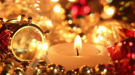 arife : candle and holiday lights close-up seamless loop Stok Video