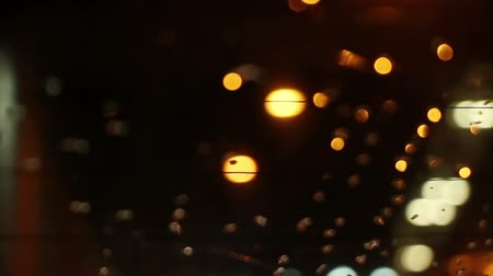 zadní : blurry lights on road through rear window of car loopable