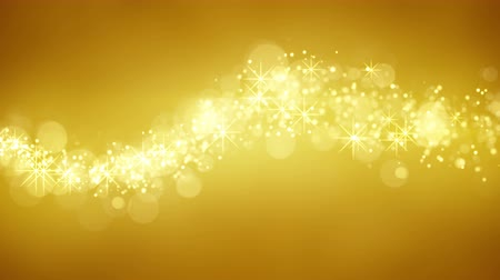 brilhar : wave of gold glitter particles. computer generated seamless loop abstract background. 4k 4096x2304 Stock Footage