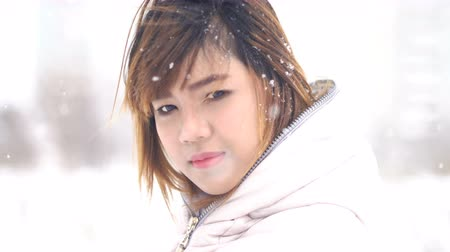 coquettish : Coquettish Asian woman winter portrait. Shallow DOF 4k UHD (3840x2160) Stock Footage