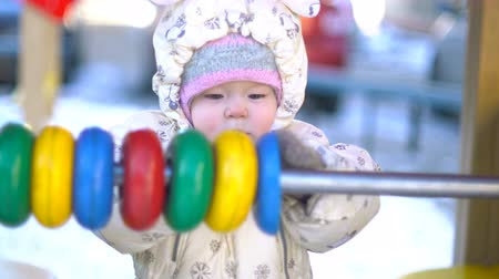 abacus : Baby girl playing with abacus in courtyard. 4k UHD (3840x2160)