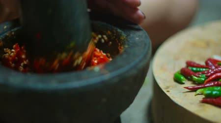 habarcs : Thai spicy chili pepper mixing in traditional marble mortar slowmotion Stock mozgókép