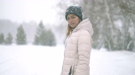 kar fırtınası : Young Woman during snow storm. 4k UHD (3840x2160) Stok Video
