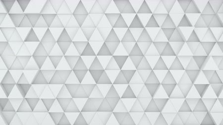 trójkąt : Light grey triangles chaotic extruding. Abstract geometric background. 3D render seamless loop smooth animation. 4k UHD (3840x2160)