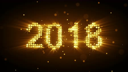 Новый год : New year 2018 greeting glowing yellow particles animation. The last 10 seconds are loopable 4k UHD (3840x2160)