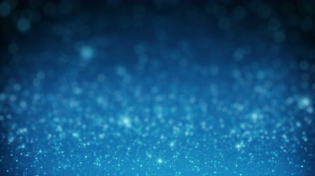 Blue glitter in light rays. Abstract holiday motion background. Computer generated seamless loop animation rendered with shallow DOF 4k (4096x2304)