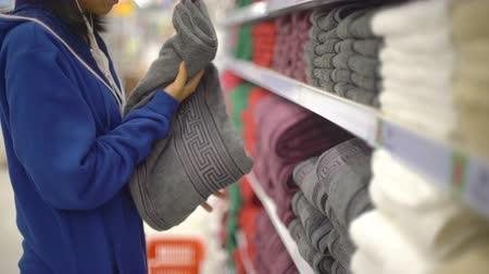 earpiece : Woman inspecting and buying towel in textile department 4k UHD (3840x2160) Stock Footage