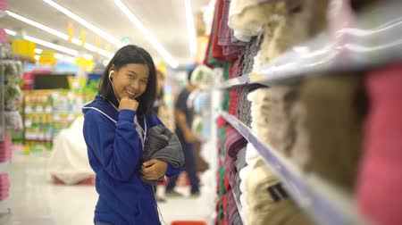 earpiece : Happy Asian Woman is buying towel in supermarket 4k UHD (3840x2160) Stock Footage