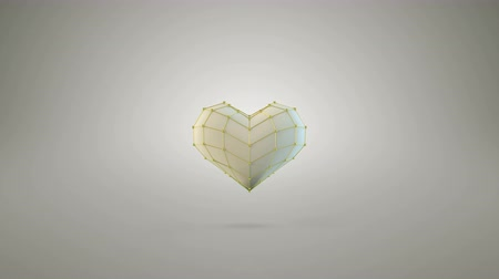endless gold : Heart shape are jumping. Creative romantic concept. 3D render. Seamless loop animation 4k UHD 3840x2160