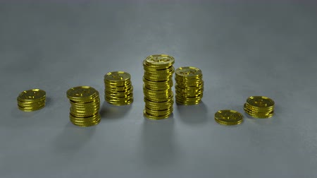входящий : Decreasing stacks of gold coins. Financial crisis concept. 3D render animation 4k UHD 3840x2160 Стоковые видеозаписи