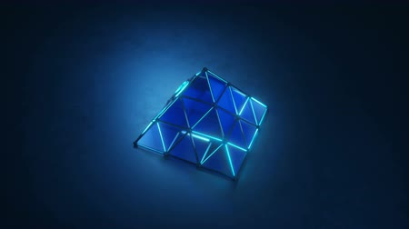 светящийся : Blue glowing pyramid shape. Abstract sci-fi concept. 3D render seamless loop animation
