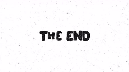elle çizilmiş : The end text grunge graphic on damaged film. Seamless loop animation Stok Video